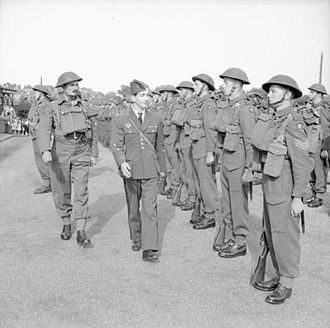 Dorset Regiment - King Peter II of Yugoslavia inspecting the Guard of Honour of a battalion of the Dorset Regiment in England.