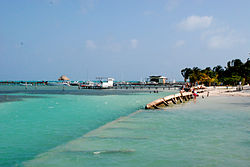 The broken breakwall creates the perfect swimming hole at the Caulker Caye Split.jpg