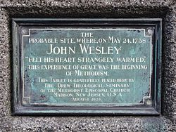 Photo of John Wesley black plaque