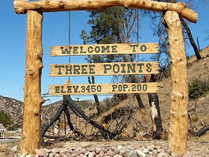 Three Points, California - Welcome sign and fire-burned trees (click to enlarge).