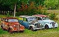 Three 1953-1957 Renault Juvaquatre vehicles, Saint-Cirq-Madelon, Lot, France (8482475728).jpg