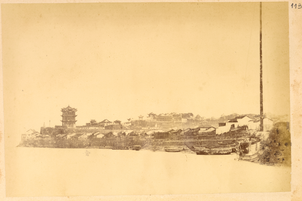 Town of Wuhan on the Bank of the Yangzi River, with View of the Huanghe Tower, Buildings, and Boats. Hubei Province, China, 1874 WDL2103