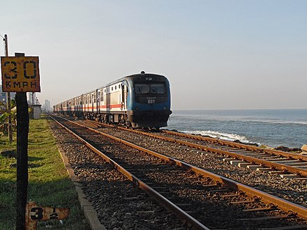 Commuter rail within the city Train track on the beach in Colombo (16779050855).jpg