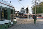 Tram in Augsburg waiting at traffic light.jpg