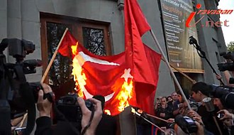Flag desecration - The Turkish flag being burnt in Freedom Square, Yerevan