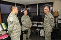 U.S. Air Force Chief Master Sgt. James Gibson, right, the senior enlisted advisor of the North Dakota Air National Guard (NDANG), visits with Tech. Sgts 130521-Z-WA217-208.jpg