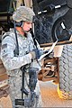 U.S. Army 1st Lt. Avi Behar, a convoy commander with the 183rd Maintenance Company, 298th Combat Sustainment Support Battalion, Task Force Resolute, makes his convoy operation checks during a resupply mission 110706-A-UB106-892.jpg