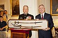U.S. Marine Corps Gen. James F. Amos, left, the commandant of the Marine Corps and the host of the Evening Parade, and Secretary of the Navy Ray Mabus, right, the Evening Parade guest of honor, exchange gifts 130531-M-KS211-203.jpg