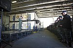 U.S. Navy Capt. Greg Fenton, the commanding officer of the aircraft carrier USS George Washington (CVN 73), addresses crew members during an all-hands call in the ship's hangar bay Jan. 3, 2014, in Yokosuka 140103-N-BX824-013.jpg