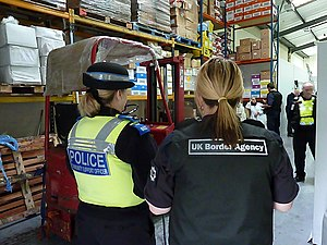 A UKBA officer and a Police CSO