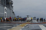 USS America deck scrubbing 140911-N-MZ309-053.jpg