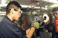 US Navy 020813-N-8770A-001 Damage Controlman buffs a stainless steel bulkhead in Damage Control Central.jpg