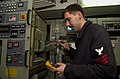 US Navy 021207-N-5152P-001 Aviation Electronics Technician 1st Class Phillip Crosby from Portland, Ore., troubleshoots a test bench.jpg