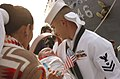 US Navy 030529-N-6639V-007 Hull Technician 2nd Class Byron Gibbs holds his son for the first time.jpg