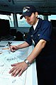 US Navy 040917-N-7232R-038 Quartermaster Seaman Maricio Auilar, of Los Angeles, Calif., plots the position of the aircraft carrier USS John C. Stennis (CVN 74) on a nautical chart during her transit through the Java Sea.jpg