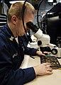 US Navy 041215-N-4166B-069 Aviation Electronics Technician 1st Class Jim Reilly inspects a Forward Looking Infrared (FLIR) Servo Control Card.jpg