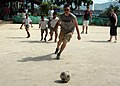 US Navy 050301-N-8955H-096 Information Systems Technician Seaman Apprentice Tyler Montgomery of Dayton, Ohio, plays soccer with students during a community service project at Kamala Primary School in Kamala, Thailand.jpg