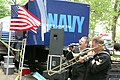 US Navy 050428-N-7975R-004 Musician 3rd Class Frank Spencer, left, sings as Musician 1st Class Stan Dunlap plays trombone.jpg