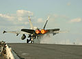 US Navy 051109-N-3488C-071 An F-A-18C Hornet, assigned to the Golden Dragons of Strike Fighter Squadron One Nine Two (VFA-192), launches off flight deck of the conventionally powered aircraft carrier USS Kitty Hawk (CV 63).jpg