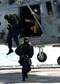 US Navy 060219-N-2445C-036 Dutch Marines exit a helicopter during a visit, board, search and seizure (VBSS) training evolution aboard the Dutch fast combat support ship HNLMS Amsterdam (A 836).jpg