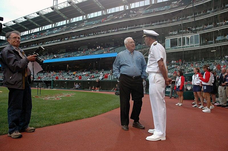 File:US Navy 060830-N-1805P-003 Amphibious transport dock ship USS Cleveland (LPD 7) Commanding Officer, Capt. Frank McCulloch and Major League Baseball Hall of Fame Inductee and World War II Navy veteran Bob Feller swap sea stories.jpg