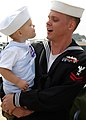 US Navy 070309-N-8544C-044 Cryptologic Technician 2nd Class Travis Baggerly embraces his son at the homecoming ceremony for guided missile frigate USS Taylor (FFG 50).jpg