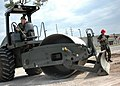 US Navy 070405-N-1325M-073 Seabees assigned to Naval Mobile Construction Battalion (NMCB) 24, and Naval Mobile Construction Battalion (NMCB) 27 grade an area during a rapid runway repair class.jpg