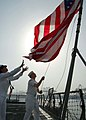 US Navy 070704-N-0515W-016 Seaman Sheila Castaneda, left, and Quartermaster 2nd Class Shane Smith observe morning colors aboard the dock landing ship USS Rushmore (LSD 47) on Independence Day 2007.jpg