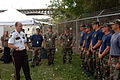 US Navy 070808-N-3093M-019 Hennepin County Sheriff Richard Stanek congratulates the new chief selects and thanks the Sailors of Mobile Diving and Salvage Unit (MDSU) 2 for their efforts in aiding with the disaster relief.jpg