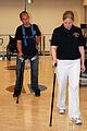 US Navy 071015-N-5086M-202 Retired Marine Corps Cpl. Timothy Jeffers walks on his prosthetic legs while using the hands-free harness walking gait training device during a therapy session in the new Comprehensive Combat and Com.jpg