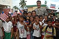 US Navy 080111-N-7286M-036 Col. William J. Coultrup, commander of the Joint Special Operations Task Force-Philippines, poses for photos with children in the Tigtabon Barungay.jpg