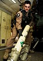 US Navy 080204-N-6855K-021 Aviation Electronics Technician 3rd Class Samuel Trapanese, assigned to Patrol Squadron (VP) 47, removes a sonobuoy casing from a pressurized launch tube after deploying a bouy.jpg