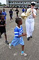 US Navy 080915-N-7526R-186 Musician 2nd Class Allison Baine plays as students at the Prytanee military school in Libreville march around her.jpg