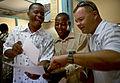 US Navy 081007-N-8977L-189 Lt. Cdr. Steve Kummeth presents local health officers a group photo.jpg