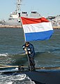 US Navy 081028-N-6011D-046 A submariner assigned to the Dutch submarine HNLMS Walrus (S802) raises the Dutch National flag after the submarine moored at Naval Station Norfolk.jpg