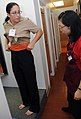 US Navy 081115-N-9758L-016 Musician 1st Class Jennifer Lange is fitted for the new service uniform at the Navy Exchange Uniform Shop.jpg