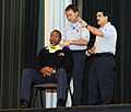 US Navy 081119-N-5345W-012 Paramedics lecture the audience about auto accident trauma response procedures during the driving safety seminar.jpg