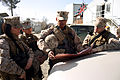 US Navy 090310-N-5952N-006 Personnel Specialist 2nd Class Glenn Kalae Paoa gives out instructions to Marines.jpg