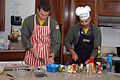 US Navy 090530-N-8629D-022 Rear Adm. Mark Guadagnini, left, Chief of Naval Air Training, and his son, Ensign Mark Guadagnini, demonstrate how to make fighter pilot chicken and helicopter rice.jpg