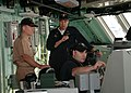 US Navy 090624-N-3844W-478 Cmdr. Michael Doran, Gold Team commanding officer of the littoral combat ship USS Freedom (LCS 1), explains ship operations to Rear Adm. Kevin Quinn, commander, Naval Surface Force Atlantic.jpg
