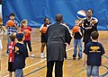 US Navy 091206-N-2013O-017 Lade Majic, Harlem Ambassadors basketball team coach and player, demonstrates proper passing techniques to children during a basketball camp sponsored by Yokosuka Morale, Welfare and Recreation Youth.jpg