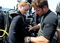 US Navy 100325-N-0553R-076 Explosive Ordnance Disposal Technician 1st Class Josh Burns, a member of Explosive Ordnance Disposal Mobile Unit (EODMU) 11, conducts a pre-dive check on Hospital Corpsman 2nd Class Ashley Wagner.jpg