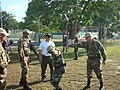 US Navy 100414-N-XXXXL-023 A member of the Security Training Assistance and Assessment Team of the Naval Criminal Investigative Service, center, in white shirt, instructs Panamanian forces on apprehension techniques.jpg