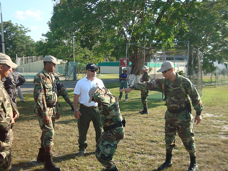 File:US Navy 100414-N-XXXXL-023 A member of the Security Training Assistance and Assessment Team of the Naval Criminal Investigative Service, center, in white shirt, instructs Panamanian forces on apprehension techniques.jpg