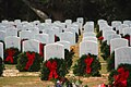 US Navy 101011-N-4482V-004 Wreaths are placed at Barrancas National Cemetery to honor fallen veterans as part of a Wreaths Across America ceremony.jpg