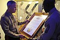 US Navy 101113-M-2581P-011 Marine Corps Gen. James F. Amos, left, and Sgt. Maj. of the Marine Corps Carlton W. Kent read a framed certificate prior.jpg