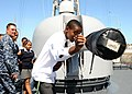 US Navy 110209-N-5085J-249 A student from the Cape Academy inspects the 76-mm cannon aboard USS Stephen W. Groves (FFG 29) during a tour of the shi.jpg