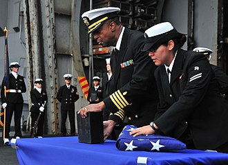 Burial at sea - Image: US Navy 110409 N 0074G 026 Sailors aboard USS Enterprise (CVN 65) prepare to cast ashes overboard during a burial at sea
