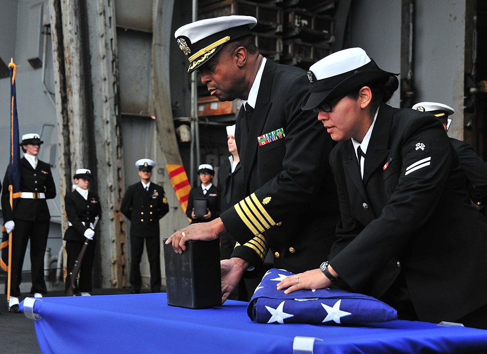US Navy 110409-N-0074G-026 Sailors aboard USS Enterprise (CVN 65) prepare to cast ashes overboard during a burial at sea