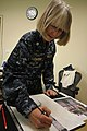 US Navy 110511-N-ZZ000-001 Cmdr. Monica Allen, a Navy combat artist specializing in watercolor, works on a new painting while deployed to Naval Air.jpg